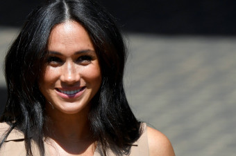 meghan markle is allegedly growing her hair to make a subtle swipe at the royal family royals meghan markle is allegedly growing her